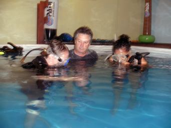 Carol and Erin trying SCUBA under the instruction of Joe.