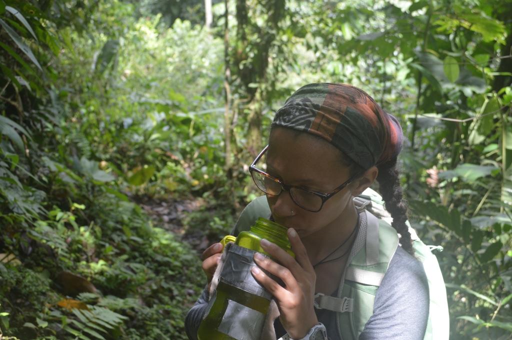 Erin taking a water break on a hike.