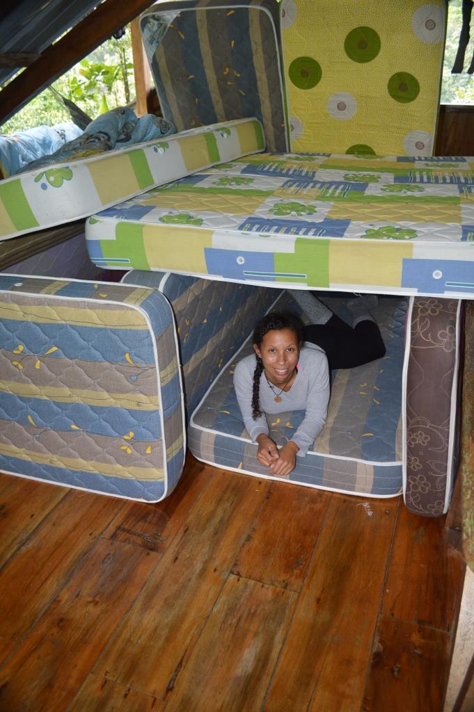 While moving mattress' around (we used them when guests stayed at the lodge) to wax the floor, I made a mattress fort...